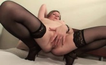 Stockinged mature fingers her cunt from behind