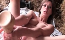 Skinny mature fucks herself with massive dildo