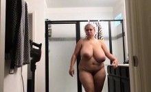 Chunky housewife with huge tits and a big round booty takes