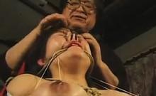 Sexy Oriental girl with big tits explores her bondage fetis