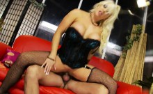 Stunning TJ in a sexy corset rides big cock on a red couch