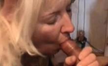 Mature blonde whore sucking cock
