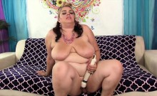 Cock hungry BBW wanks her plump pussy with a fat dildo and