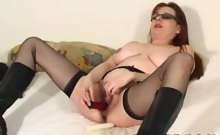 Older and grotesque mom fucks her dirty pussy with two 'lil