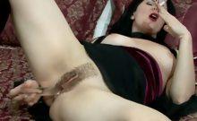 Brunette whore masturbating while smoking