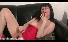 Horny smoking Mina masturbates her pussy on the couch