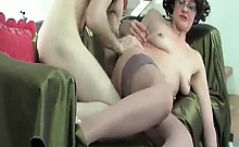 Mature brunette slut with some sexy stockings seduces her