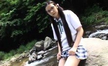 Petite Oriental schoolgirl drops her clothes and makes herself cum