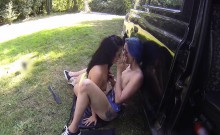 Lesbians plays with toys in taxi