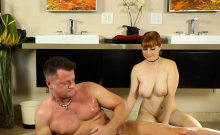 Busty Redhead gives Cock Therapy