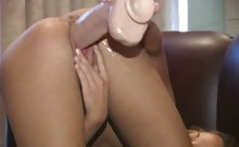Jamie pounds her snatch with a big brutal dildo